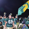 WARREN DILLAWAY / Star Beacon<br /> GARRETT VAUGHT (68) and Troy Tomchak (16) celebrate with Lakeside teammates after defeating Jefferson during a home game Friday eveninnnng.