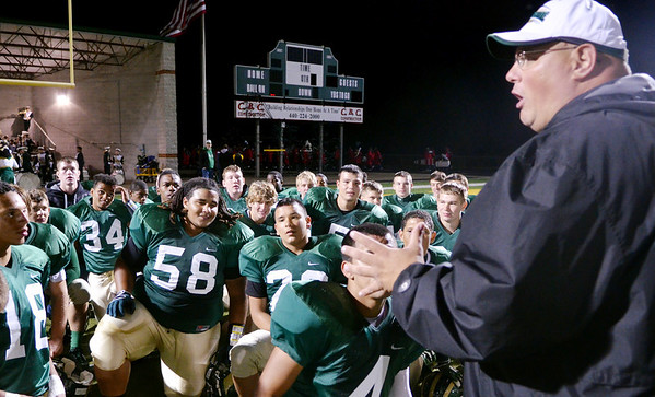 WARREN DILLAWAY / Star Beacon<br /> FRANK HALL, Lakeside football coach, addresses his team on Friday night after the Dragons defeated Jefferson at    Lakeside.