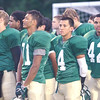 WARREN DILLAWAY / Star Beacon<br /> LAKESIDE DRAGONS (from left) Tyler Loftus, Malik Carlton, Mo Lebron and Tyree Meeks wait to enter the field during the National Anthem on Friday night prior to a home game with Jefferson.