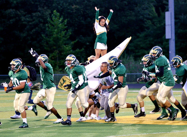 WARREN DILLAWAY / Star Beacon<br /> THE LAKESIDE Dragons enter the field of play on Friday prior to a home game with Jefferson.
