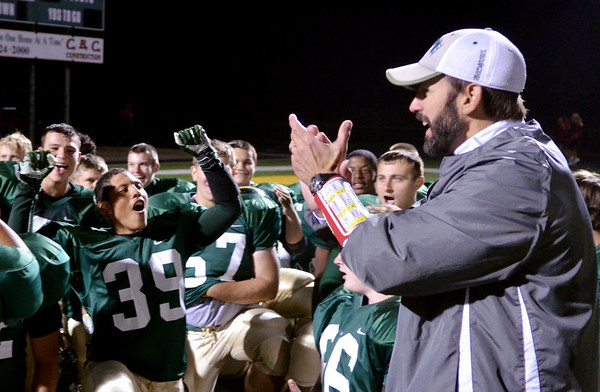 WARREN DILLAWAY / Star Beacon<br /> RAY ENRICCO, Lakeside assistant football coach, addresses celebrates with the team  on Friday night after the Dragons defeated Jefferson at  Lakeside.