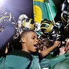 WARREN DILLAWAY / Star Beacon<br /> JOHNNY EVANS of Lakeside (center) celebrates with teammates on Friday night after the Dragons defeated Jefferson at Lakeside.