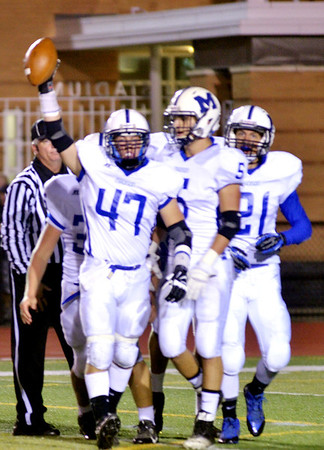 WARREN DILLAWAY / Star Beacon<br /> ANDREW SCHIEMANN (47) of Madison recovers a fumble and celebrates with teammates Brandon Davis (5) and Matt Atha (21) on Friday night at Perry.