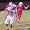 WARREN DILLAWAY / Star Beacon<br /> CONNOR NIKSES of Madison runs the ball on Friday night with Nick Lauria (47) of Perry on Friday night at Perry.