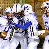 WARREN DILLAWAY / Star Beacon<br /> ANDREW SCHIEMANN (47) of Madison recovers a fumble and celebrates with teammates Brandon Davis (5) and Matt Atha (21) and on Friday night at Perry.