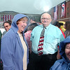 WARREN DILLAWAY / Star Beacon<br /> ASHTABULA RESIDENTS Linda (center sweat shirt) and Rev. Stephen Long (with tie) wait for the Mitt Romney presidential campagin rally to start Friday at Lake Erie College in Painesville.