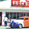 WARREN DILLAWAY / Star Beacon<br /> HOT ROD cars from the 1950s were out in force Saturday along the Strip at Geneva-on-the-Lake during the first edition of the American Graffitti North Shore. Jesse Bilicic (fourth from left) organized the event to approximate the American Graffitti era.
