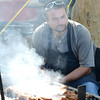 WARREN DILLAWAY / Star Beacon<br /> DON CLUGH of Cunningham's keeps a close eye on chicken and ribs on Saturday at the Conneaut Rib Burn Off at Conneaut Townsship Park.