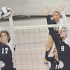 WARREN DILLAWAY / Star Beacon<br /> MALLORY SHELLENBERGER (left) and St. John teammate Mackenzie Stenroos (8) leap to block a spike by Cassandra Ohler of Ledgemont  on Monday at Spire Institute in Harpersfield Township.