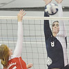 WARREN DILLAWAY / Star Beacon<br /> MACKENZIE STENROOS (8) of St. John leaps for a block of a spike by Jessica Fontana of Ledgemont  on Monday at Spire Institute in Harpersfield Township.