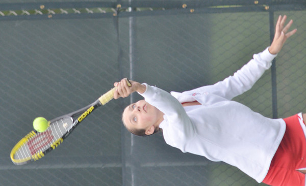 WARREN DILLAWAY / Star Beacon<br /> DIEDRA YAN of Geneva serves during a home first doubles match with Lakeside on Monday.