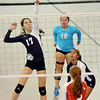 WARREN DILLAWAY / Star Beacon<br /> MALLORY SHELLENBERGER (17) leaps for a spike as St. John teammates Emily Powers (12) and Alicia Ngiraingas look on with Autumn Lang of Ledgemont Monday evening at Spire Institute.