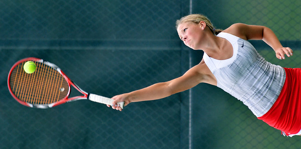 WARREN DILLAWAY / Star Beacon<br /> SYDNEY VANHOY of Geneva serves on Monday during home a second doubles match with Lakeside.