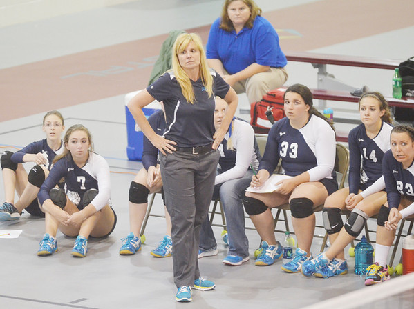 WARREN DILLAWAY / Star Beacon<br /> STEPHANIE KUBEC, St. John volleyball coach, (standing center) watches the action on Monday during a match with Ledgemont at Spire Institute in Harpersfield Township.