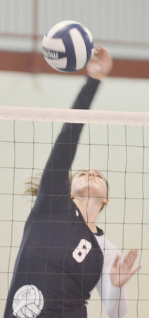WARREN DILLAWAY / Star Beacon<br /> MACKENZIE STENROOS of St. John leaps for a spike on Monday during a match with Ledgemont at Spire Institute ain Harpersfield Township.