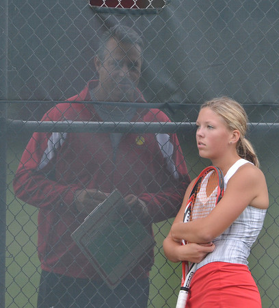 WARREN DILLAWAY / Star Beacon<br /> SYDNEY VANHOY of Geneva talks with coach Scott Torok on Monday during a break in a second doubles match with Lakeside.