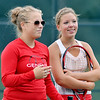 WARREN DILLAWAY / Star Beacon<br /> KAYLA HUFF (left) of Geneva and doubles partner Sydney Van Hoy share a light moment during a match with Lakeside on Monday.