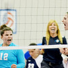 WARREN DILLAWAY / Star Beacon<br /> MACKENZIE STENROOS (right) and St. John teammate Emily Powers celebrates with coach Stephanie Kubec on Monday during a match against Ledgemont at Spire Institute.