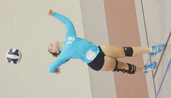 WARREN DILLAWAY / Star Beacon<br /> EMILY POWERS of St. John serves on Monday during a match with Ledgemont at Spire Institute.
