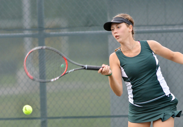 WARREN DILLAWAY / Star Beacon<br /> KATIE ALLEN of Lakeside returns a shot during a first singles match with Alyx Lynham of Geneva on Monday at Geneva.