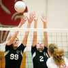 WARREN DILLAWAY / Star Beacon<br /> HAYLEY ALLEN (99) and Jefferson teammate Bailey Beckwith reach for a block of an Edgewood spike by Edgewood's Haley Holden Monday evening at Edgewood.
