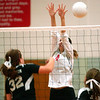 WARREN DILLAWAY / Star Beacon<br /> KATIE THOMAS (4) of Edgewood leaps for a block of a spike by Jefferson's Lee Ann Farr (32) Monday at Edgewood.