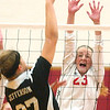WARREN DILLAWAY / Star Beacon<br /> ALYSSA JOHNSON of Edgewood  (23) leaps for a block as Jefferson's Alyssa Irons goes up for the spike Monday night during a home match with Jefferson.