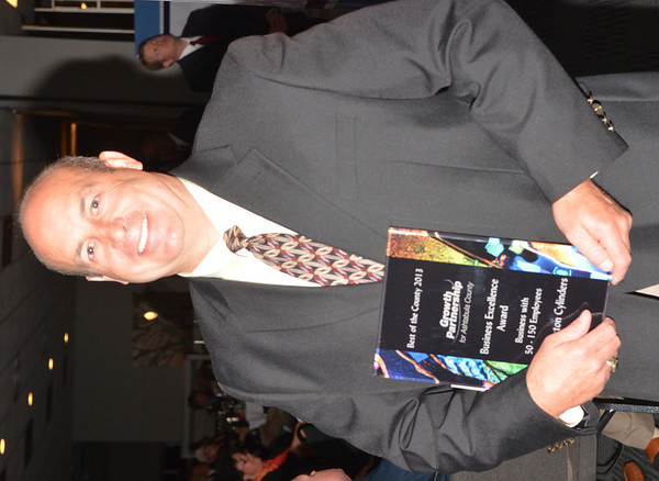WARREN DILLAWAY / Star Beacon<br /> DAN BRUBAKER, receives the Best of County Business Excellence Award for 50 to 100 employees for Worthington Cylinders on Tuesday night during the Growth Partnership for Ashtabula County awards dinner at Spire Institute in Harpersfield Township.