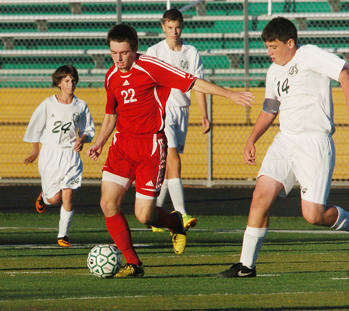 WARREN DILLAWAY / Star Beacon<br /> CHAD WEISBARTH (22) of Geneva dribbles between Mitchell Strong (24) and Jared Kingston of Lakeside (14) on Tuesday afternoon at Lakeside.