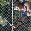 WARREN DILLAWAY / Star Beacon<br /> SAM BRADEN of Edgewood serves during a second singles match Thursday at Conneaut.