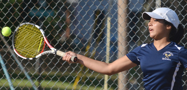 WARREN DILLAWAY / Star Beacon<br /> AMANDA CHADWICK of Conneaut returns a shot during a first singles match against Sandy Dickey of Edgewood on Thursday at Conneaut.
