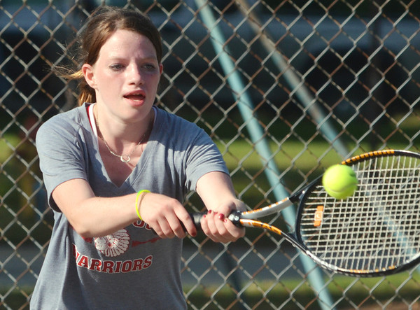 WARREN DILLAWAY / Star Beacon<br /> SANDY DICKEY of Edgewood returns a shot during a first singles match against Amanda Chadwick of Conneaut on Thursday at Conneaut.