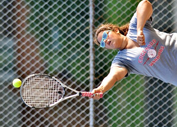 WARREN DILLAWAY / Star Beacon<br /> SAM BRADEN of Edgewood serves during a second singles match Thursday during a tennis match at Conneaut.