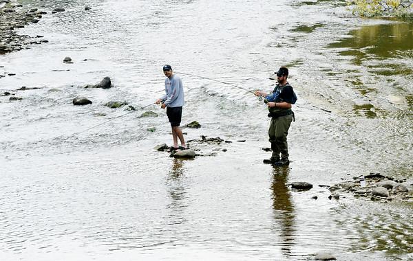 WARREN DILLAWAY / Star Beacon<br /> FISHERMEN WORK Conneaut Creek on Thursday aftrnoon in Conneaut.