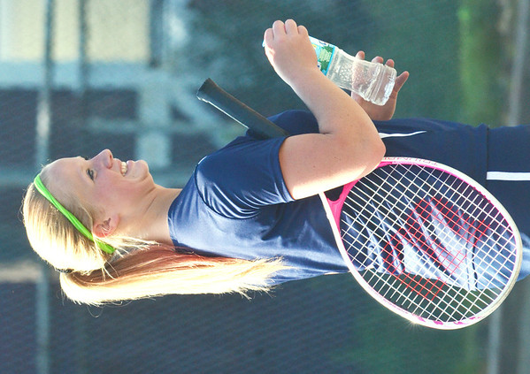WARREN DILLAWAY / Star Beacon<br /> HAILEY LARUSCH of Conneaut is all smiles during a break in a second singles match with Sam Braden of Edgewood on Thursday at Conneaut.