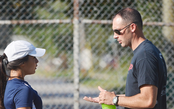 WARREN DILLAWAY / Star Beacon<br /> ADAM LYTLE, Conneaut tennis coach, talks with firsts singles player Amanda Chadwick on Thursday during a home match with Edgewood.