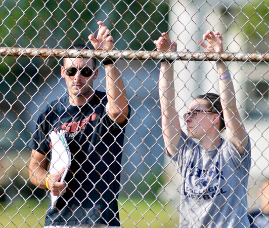 WARREN DILLAWAY / Star Beacon<br /> CONNEAUT TENNIS Coach Adam Lytle (left) and his assistant Becky Betterdge watch the action on Thursday during a home match with Edgewood.