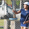 WARREN DILLAWAY / Star Beacon<br /> AMANDA CHADWICK of Conneaut returns a shot during a first singles match with Sandy Dickey of Edgewood on Thursday at Conneaut.
