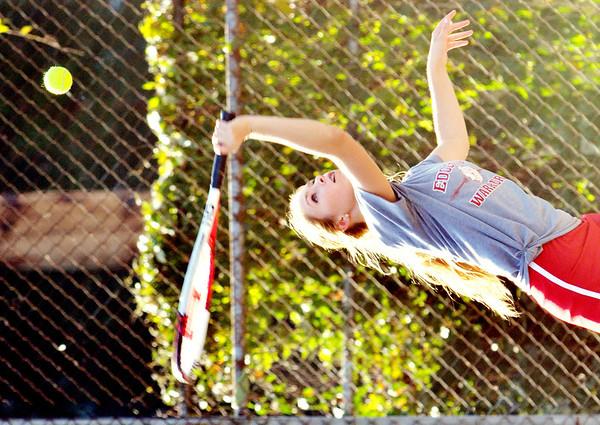 WARREN DILLAWAY / Star Beacon<br /> ALLISON MASSARO of Edgewood serves on Thursday during a tennis match at Conneaut.
