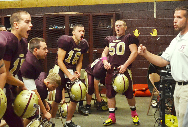 WARREN DILLAWAY / Star Beacon<br /> NEAL CROSTON, Pymatuning Valley football coach, gives a pre-game talk as Travis Kiser (far left), Cody Miller (16) , Colin Winkler (50) and the rest of the Lakers get ready for Friday night action prior to a home game with Edgewood.