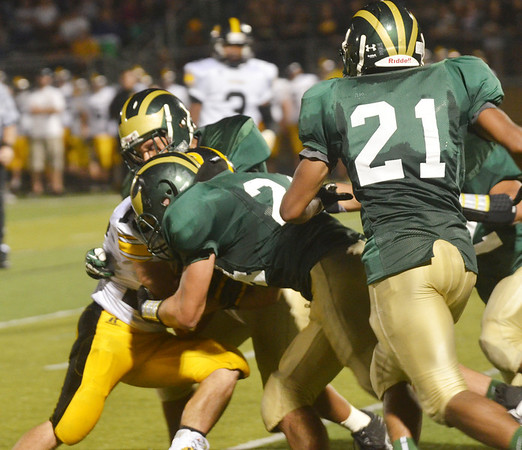 WARREN DILLAWAY / Star Beacon<br /> PAT REMINGTON (face hidden) of Riverside is squeezed by Kyle Downs (center) as Dragon teammate Malik Carlton (21) arrives on the scene on Friday night at Lakeside.