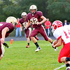 WARREN DILLAWAY / Star Beacon<br /> ALEX NEWSOME (14) of Egdewood tries to find running room as Pymatuning Valley defenders Quuuuintin Ratliff (6) and Nick Holt (32) close in Friday evening in Andover Township.
