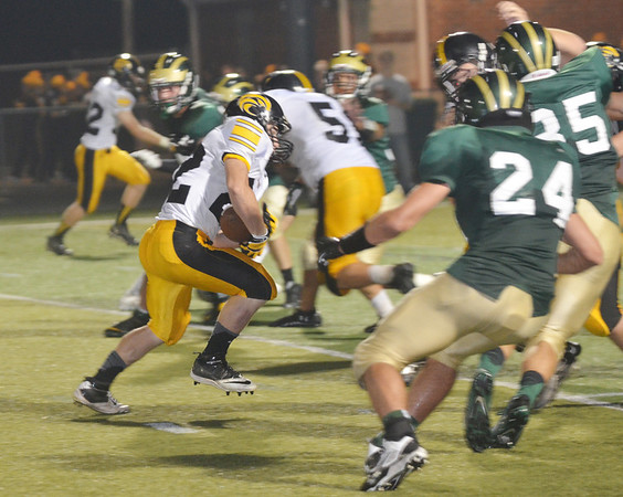 WARREN DILLAWAY / Star Beacon<br /> NICK SCHOVAL (with ball) of Riverside tries to find running room as Lakeside defender Kye Downs follows the play on Friday at Lakeside.