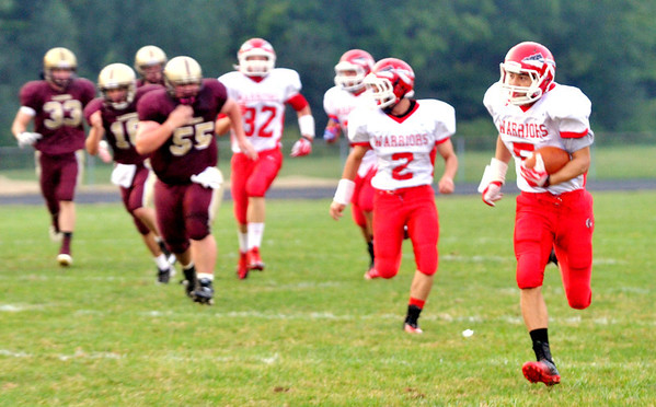 WARREN DILLAWAY / Star Beacon<br /> RIIS SMITH of Edgewood breaks a long punt return on Friday at Pymatuning Valley.