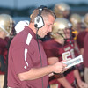 WARREN DILLAWAY / Star Beacon<br /> NEAL CROSTON, Pymatuning Valley football coach, reviews his plays Friday night during a home game with Conneaut.