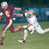 WARREN DILLAWAY / Star Beacon<br /> QUINTIN RATLIFF (6) of Pymatuning Valley tries to escape Conneaut's R.J. Nelson Friday night at Pymatuning Valley.