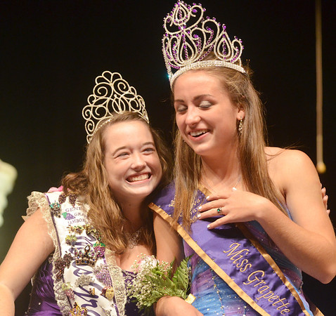 WARREN DILLAWAY / Star Beacon<br /> EMILY DEERING (right) receives congratulations after she was crowned Miss Grapette by outgoing queen Katie Peck (left) on Saturday night at Geneva High School.