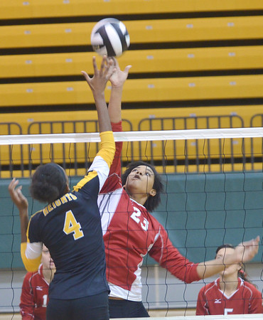 WARREN DILLAWAY / Star Beacon<br /> ISHA NICIU (23) of Edgewood leaps for the spike as Omotayo Agaja (4) of Cleveland Heights waits to react on Saturday during the Lakeside Volleyball Tournament on Saturday in Saybrook Townshp.