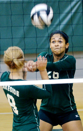 WARREN DILLAWAY / Star Beacon<br /> AALIYAH ALLGOOD of Lakesie sets the ball in front of teammateAndrea Davis on Saturday morning during the Lakeside volleyball Tournament.