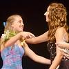 WARREN DILLAWAY / Star Beacon<br /> EMILY DEERING (left) receives congratulations from Deidra Yan after she was chosen Miss Grapette by  on Saturday night at Geneva High School.